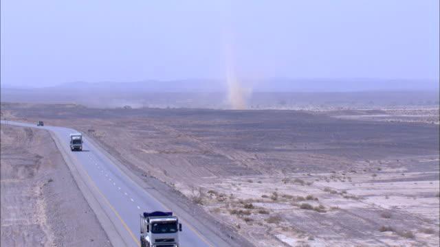 aerial road and dust devil in negev desert, negev, israel - dammstorm storm bildbanksvideor och videomaterial från bakom kulisserna