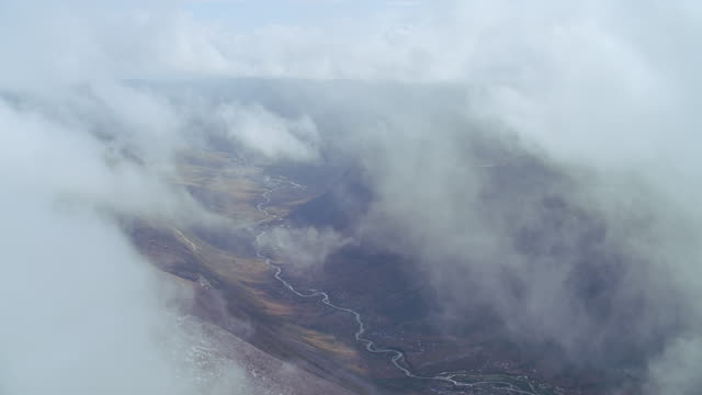 aerial rocky green hills, some snow, scotland - valley type stock videos & royalty-free footage