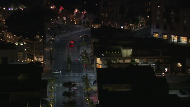 aerial ts rodeo drive to regent beverly wilshire hotel / beverly hills, california, united states - beverly hills stock-videos und b-roll-filmmaterial