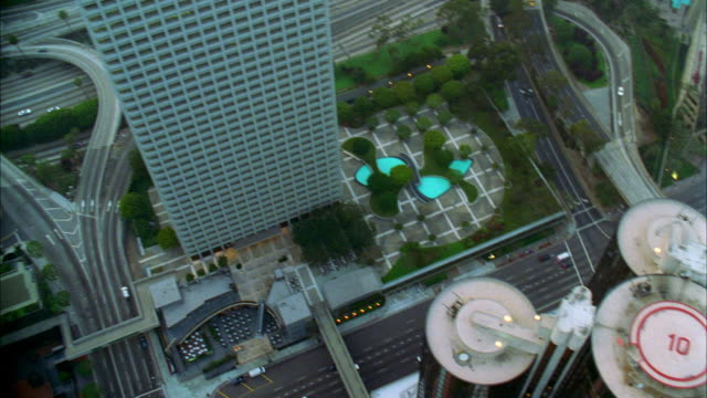 aerial rooftops of skyscrapers and city streets of downtown los angeles / california - 2002 stock videos & royalty-free footage
