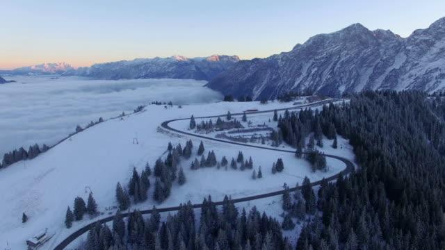 Aerial: Rossfeld, Bavaria, at sunrise in winter
