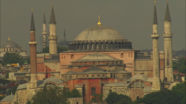 aerial rotate around hagia sofia mosque to reveal suleymaniye mosque in background - suleymaniye mosque stock videos and b-roll footage