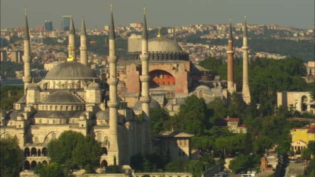 aerial rotate around hagia sophia then suleymaniye mosques with istanbul in background - suleymaniye mosque stock videos and b-roll footage