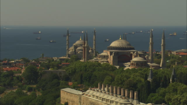 aerial rotate around suleymaniye and hagia sofia mosques - eminonu district stock videos and b-roll footage