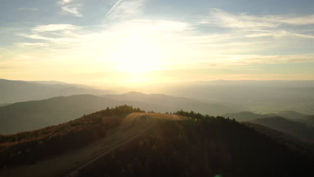 aerial rotating drone shot of the hills above southern germany at sunset - hill stock videos & royalty-free footage