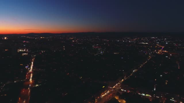 Aerial rotating panoramic drone shot at night in Sofia city downtown district