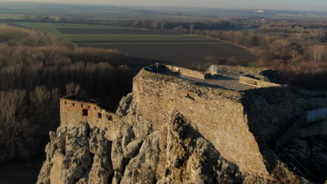 aerial: ruins of devin castle and rural landscape in bratislava, slovakia - slovakia stock videos & royalty-free footage