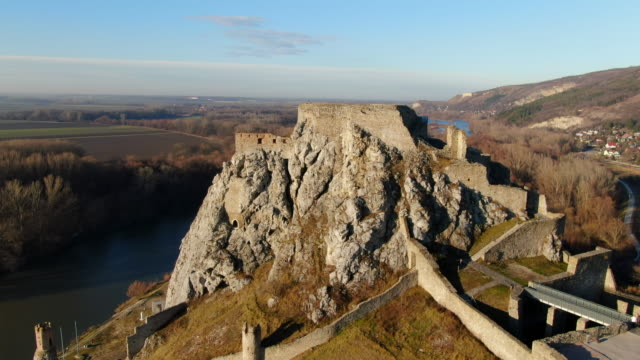 aerial: ruins of devin castle and surrounding landscape in bratislava, slovakia - slovakia stock videos & royalty-free footage