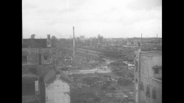 aerial ruins of postworld war ii tokyo / ground level of rubble / people clearing rubble / intact bank safe / vs ruins civilians in makeshift home... - civilperson bildbanksvideor och videomaterial från bakom kulisserna