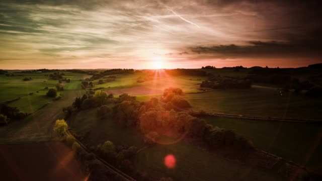 aerial : rural countryside in germany at sunrise - eifel - rolling landscape stock videos & royalty-free footage
