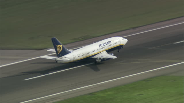 Aerial Ryanair jet taking off at Stansted Airport / Essex, England