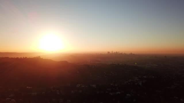 Aerial: LA's Silhouette Against The Setting Sun