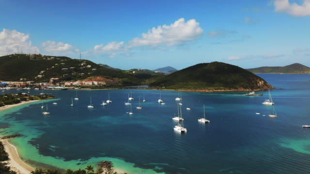 aerial: sailboats anchored in an inlet off an island in st. croix, us virgin islands - inlet stock videos & royalty-free footage