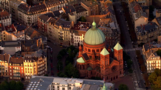 Aerial WS Saint Pierre le Jeune Church and surrounding city / Strasbourg, Alsace, France