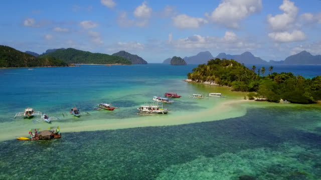 aerial: sandbank with banca boats anchored in palawan, philippines - anchored stock videos & royalty-free footage