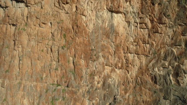 aerial sandstone rock face triangulo rojo (red triangle) wall. - sandstone stock videos & royalty-free footage