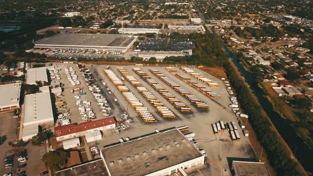 aerial scenes of a school bus lot along summit blvd. in central west palm beach, florida in april of 2021 during the final few months of school during covid-19 - high up stock videos & royalty-free footage