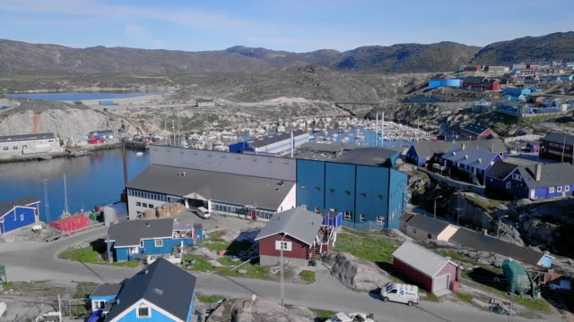 aerial: scenic port of picturesque town by rocky cove, disko bay, greenland - greenland stock videos & royalty-free footage