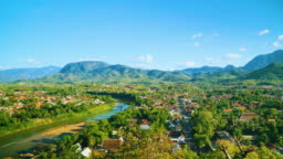 Aerial Scenic View of Luang Prabang City and Surrounding Countryside on a Bright Sunny Summer Day