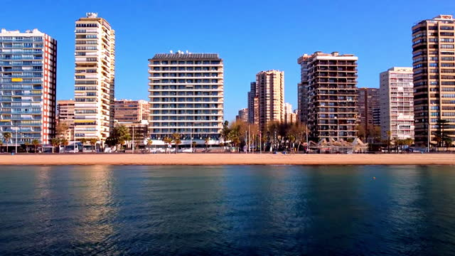 aerial sea, beach and hotels in benidorm - spain stock videos & royalty-free footage
