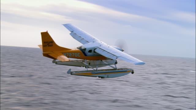 Aerial seaplane flying over Atlantic Ocean/ Florida