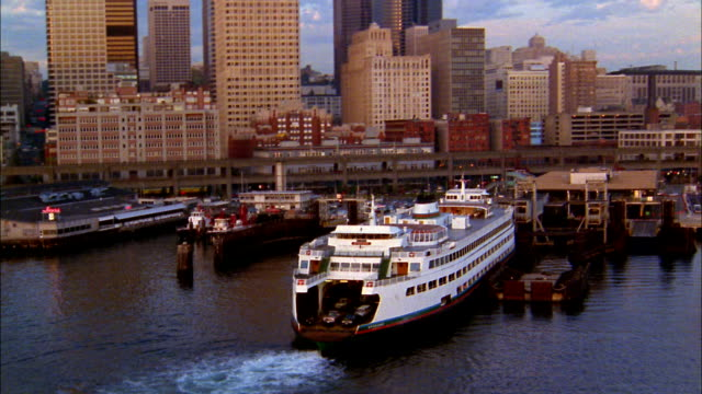 aerial seattle harbor w/skyscrapers and ferry in harbor - ferry stock videos & royalty-free footage