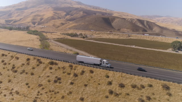 aerial semi truck driving on the road - articulated lorry stock videos & royalty-free footage