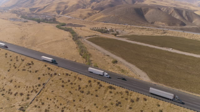 aerial semi truck driving on the road - freight transportation stock videos & royalty-free footage
