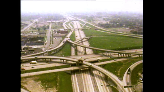aerial sequence of busy freeways in detroit; 1972 - motorway junction stock videos & royalty-free footage