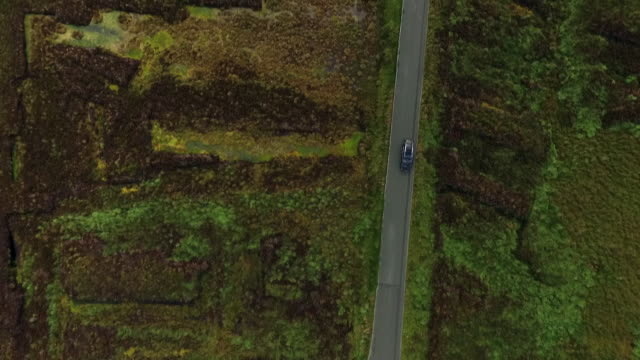 vidéos et rushes de aerial sequence showing a drive in an audi q3 car over moorland in wicklow mountains national park, county wicklow, republic of ireland. - irlande