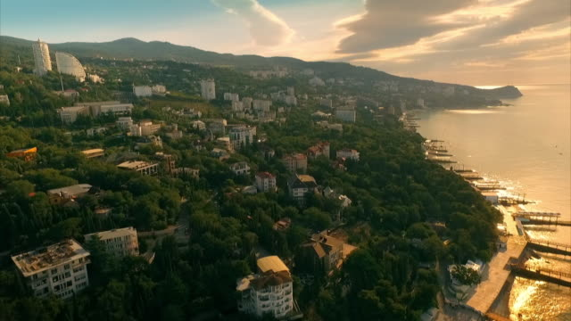 aerial sequence showing a resort town on crimea's coastline popular with russian holidaymakers visiting sanitoriums. - jetty stock videos & royalty-free footage