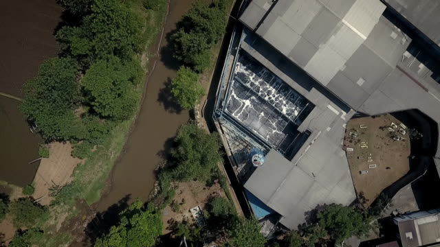 aerial sequence showing factories allegedly pumping toxic waste into the river citarum, indonesia. - 織物点の映像素材/bロール