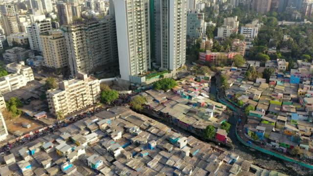 aerial: shanties by modern residential skyscrapers - mumbai, india - mumbai stock videos & royalty-free footage