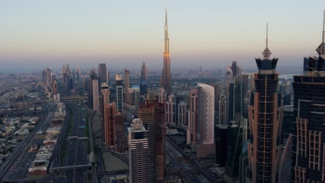 aerial sheikh zayed road city skyscrapers sunset dubai - mode of transport stock videos & royalty-free footage