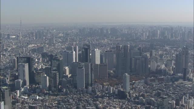 aerial shinjuku skyscrapers in tokyo - wide shot stock videos & royalty-free footage