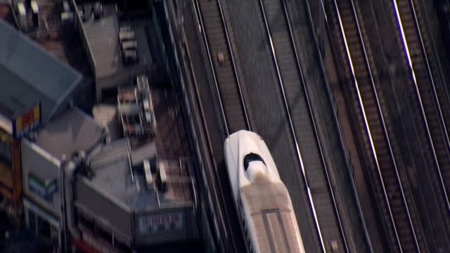 aerial shinkansen tgv bullet train motion tokyo city - エンジン点の映像素材/bロール