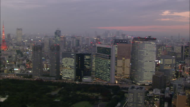 Aerial Shiodome area and Tokyo Bay at twilight/ Tokyo