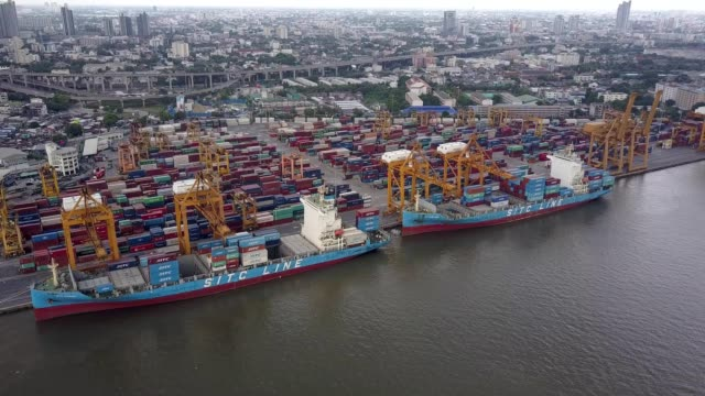 aerial shoot of containers at bangkok commercial port along jao phra ya river, bangkok, thailand. - docks stock videos and b-roll footage