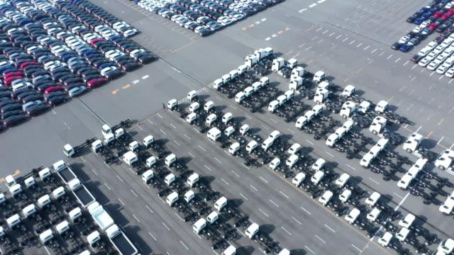 aerial shoot of many cars before shipment - 繁栄点の映像素材/bロール