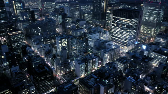 aerial shoot of office buildings in business street - night stock videos & royalty-free footage