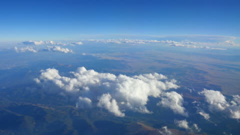aerial shot above the clouds in 4k - stratosphere stock videos & royalty-free footage