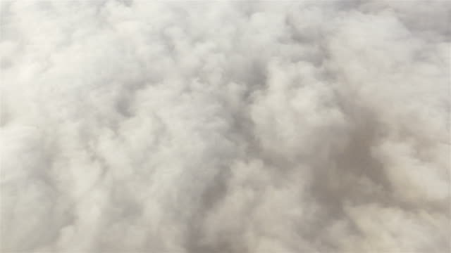 aerial shot above the clouds in 4k - cumulus cloud stock videos & royalty-free footage