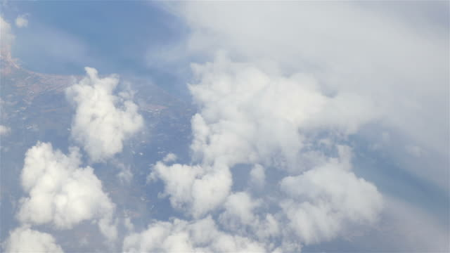 Aerial shot above the puffy clouds in 4K