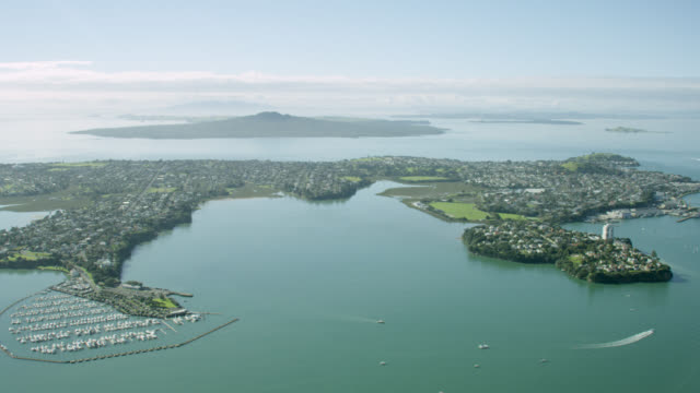 Aerial shot across Auckland's north shore towards Rangitoto Island