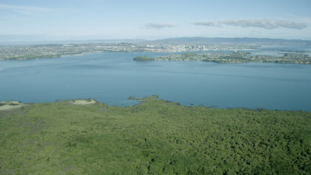 Aerial shot across Waitemata Harbour towards Auckland City
