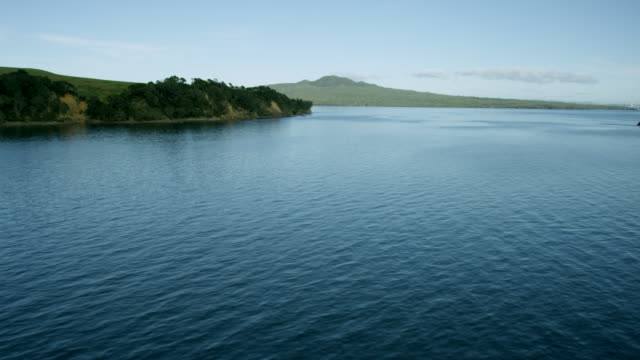 Aerial shot across water towards Rangitoto Island.