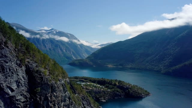 aerial shot along the geirangerfjord on sunny day/ norway - fjord stock videos & royalty-free footage