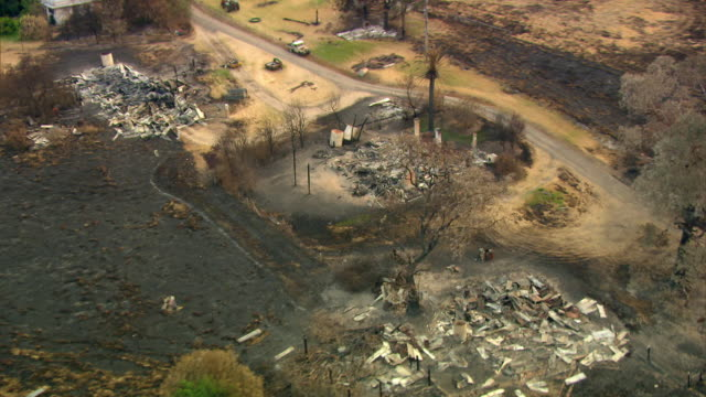 aerial shot around a house destroyed by forest fires in new south wales. - forest fire stock videos & royalty-free footage