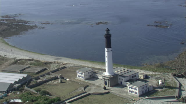 Aerial shot around the Isle of Sein lighthouse.