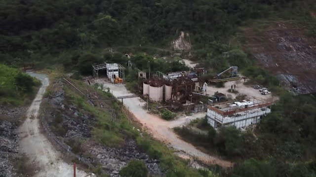 aerial shot away from abandoned gold mine and over mountain of contaminated rock in rio acima brazil - abandoned stock videos & royalty-free footage